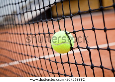 tennis ball hit the net - stock photo