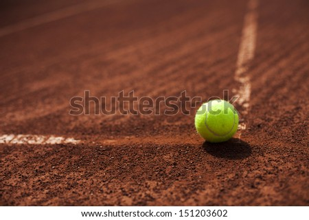 Tennis ball in the corner of the court - stock photo