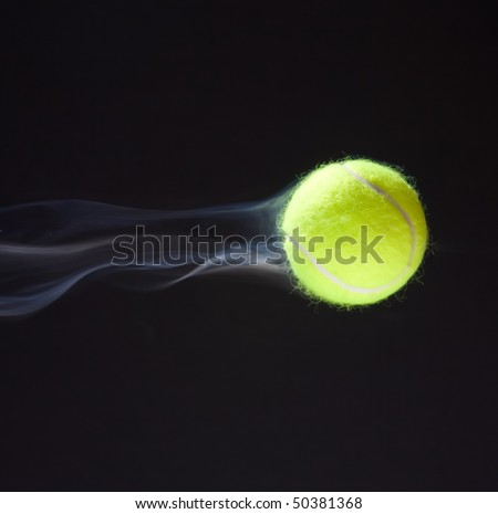 Tennis ball moving fast giving illusion of smoke behind it. - stock photo