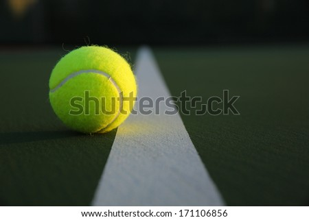 Tennis Ball near the Court Line with room for copy - stock photo