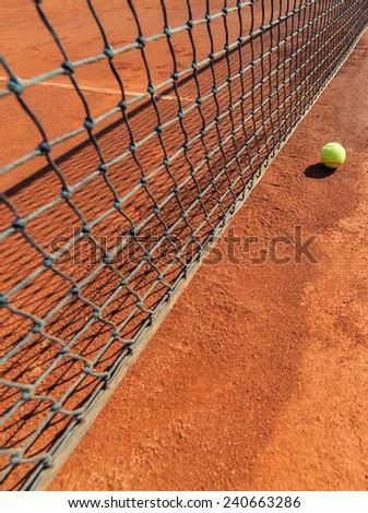 tennis ball next to net - stock photo