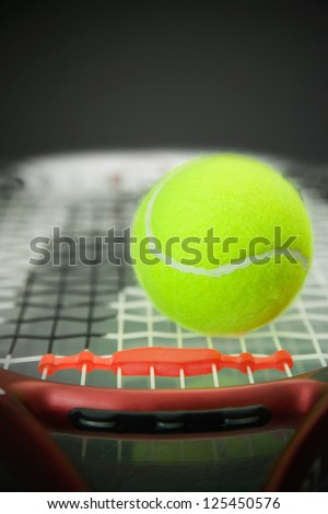 Tennis ball on a Carbon Graphite tennis racket