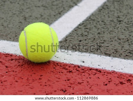 Tennis Ball on a court line - stock photo