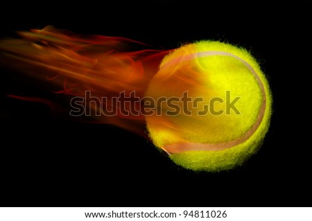Tennis Ball on fire and Smoking Hot. - stock photo