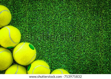 tennis ball on green background top view mock up.