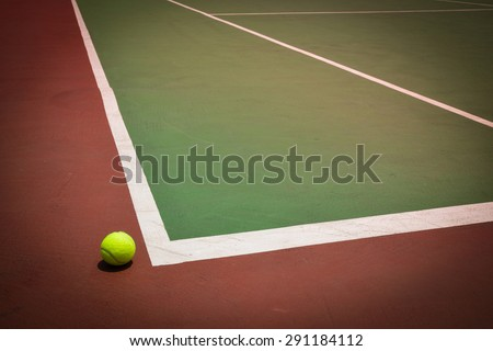 tennis ball on green court, sport background - stock photo