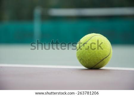 tennis ball on the court - stock photo