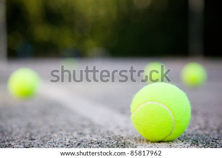tennis ball on the court line - stock photo