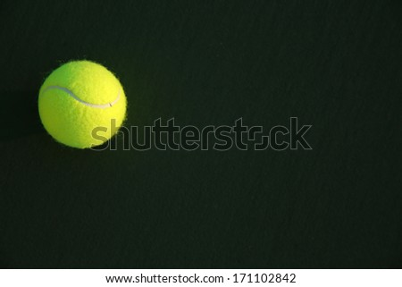 Tennis Ball on the Court with Copy Space - stock photo