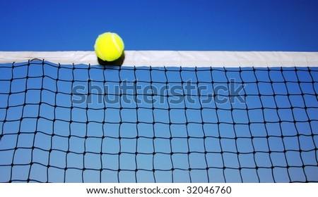 Tennis Ball on the Net - stock photo