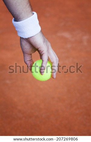 tennis ball, preparing for serve - stock photo