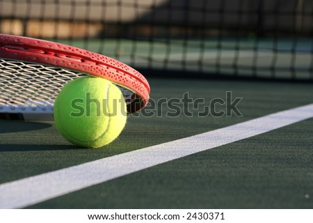 Tennis ball with a detailed racket - stock photo