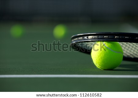 Tennis Balls and a Racket on the Court with room for copy - stock photo