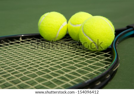 Tennis Balls on a Racket with room for copy  - stock photo