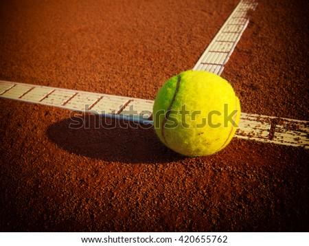Tennis balls on a tennis clay court - stock photo