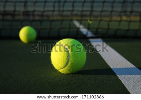 Tennis Balls on the Court Close up with room for copy - stock photo