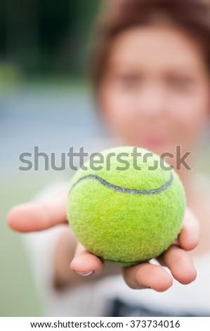 Tennis balls on woman's hand, Close up shot - stock photo