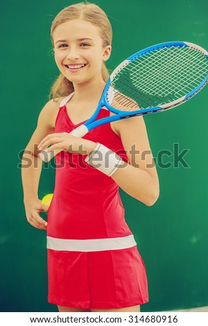 Tennis - beautiful and young girl tennis player - stock photo