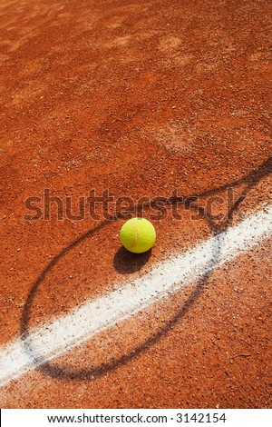 Tennis Concept - tennis ball near line with racket shadow over - stock photo