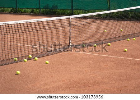 Tennis court and yellow ball before net - stock photo