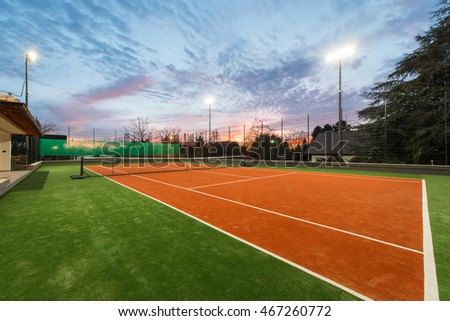 Tennis court at a private estate in the twilight and magic sky