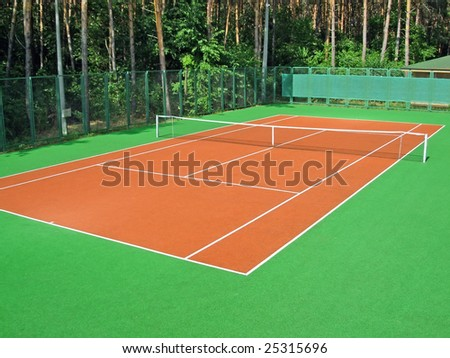 Tennis court in coniferous wood - stock photo