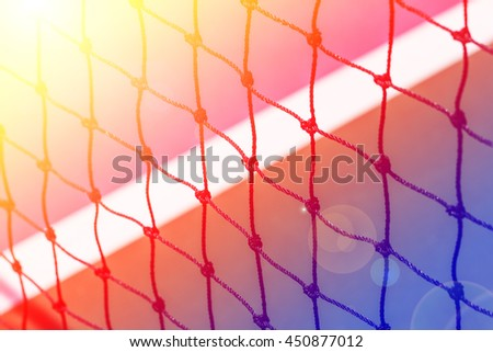 Tennis court net close up with color filters - stock photo