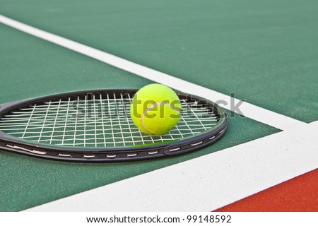 Tennis court with ball and racket - stock photo