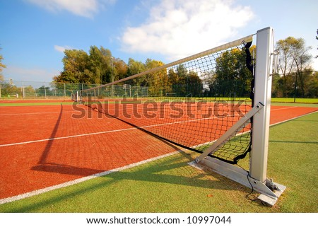 tennis court with dynamic line of net - stock photo