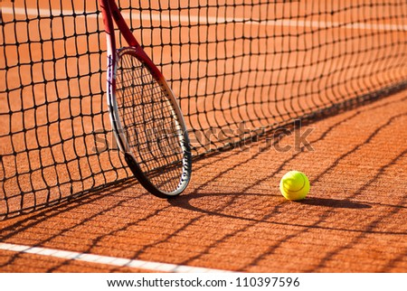 tennis court with tennis ball and racket - stock photo