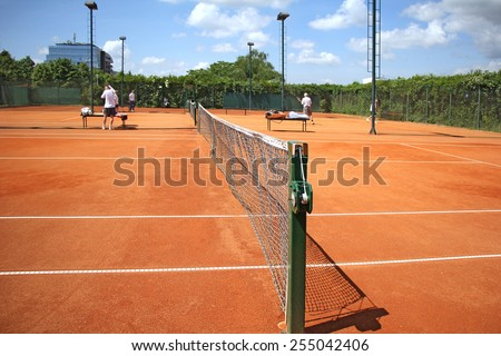 Tennis courts and play pairs, on a nice sunny day  - stock photo