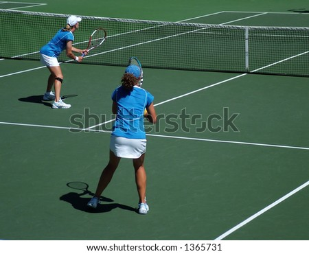 Tennis doubles match - team players