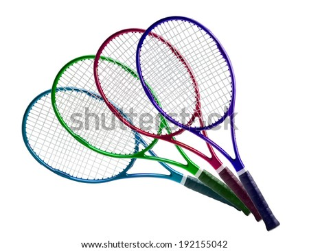 Tennis equipment: colorful rackets isolated on white background - stock photo