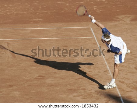 Tennis man in action on royal court