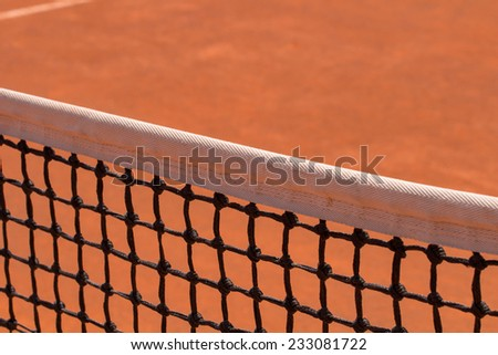 Tennis net on a clay court.  - stock photo