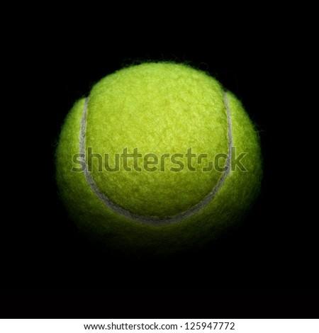 Tennis on black background - stock photo