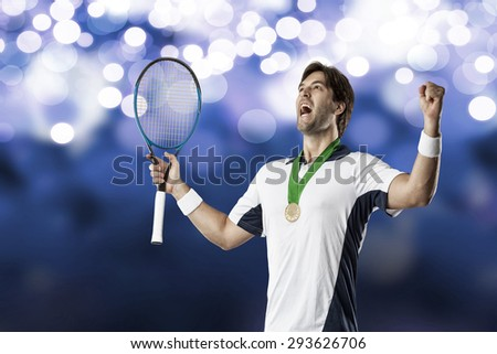 Tennis player celebrating with a gold medal, on a blue lights background. - stock photo