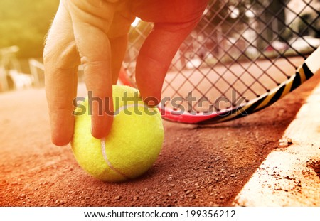 tennis player gets the ball  - stock photo