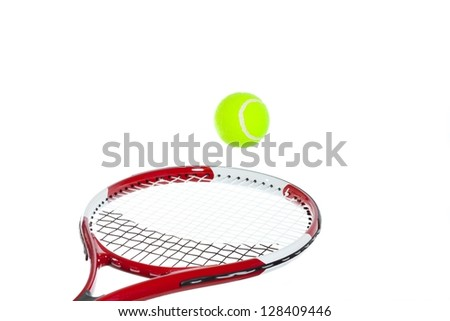 Tennis player hitting a tennis ball on white background