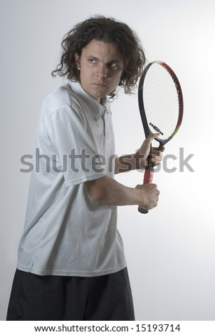 Tennis Player holding a racket preparing to hit a backhand - Vertically framed photograph - stock photo
