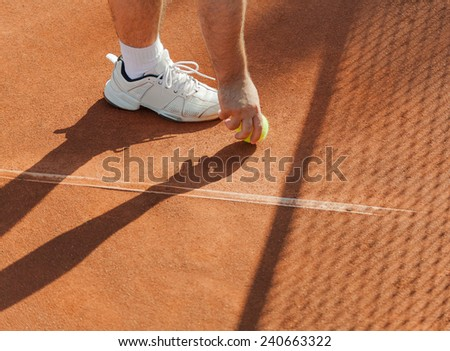 tennis player is about to take the ball near the net - stock photo