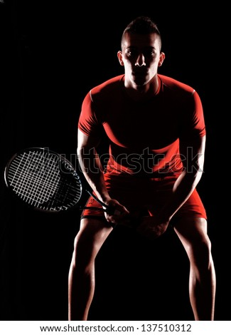 Tennis player on black background. - stock photo