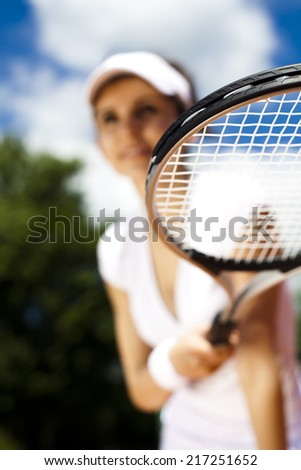 Tennis player on court  - stock photo