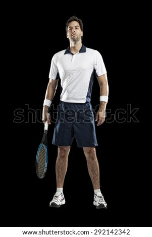 Tennis player playing on a black background. - stock photo