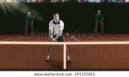Tennis player playing on a clay tennis court. - stock photo