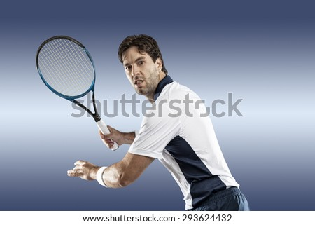 Tennis player playing on blue background.