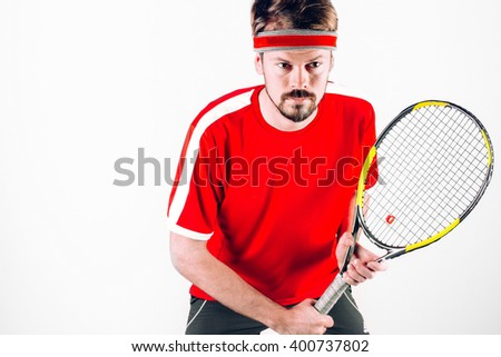 Tennis player/ Tennis player isolated on white background. Man playing tennis. Tennis player holding a racket in your hand. Studio shot. - stock photo