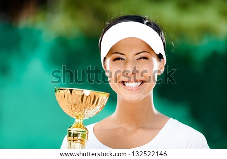 Tennis player won the cup at the sport contest. Trophy - stock photo