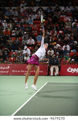 Tennis queen Maria Sharapova serving during her match with fellow Russian Galina Voskoboeva at the Qatar Total Open, February 20, 2008 - stock photo