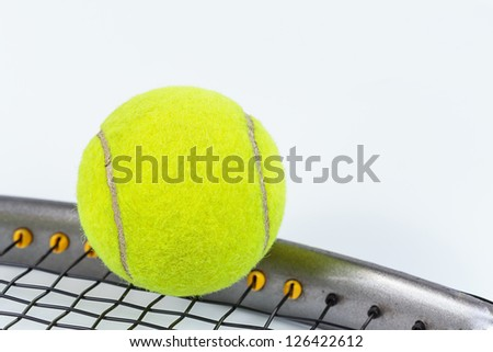 Tennis racket and ball isolated on white background - stock photo